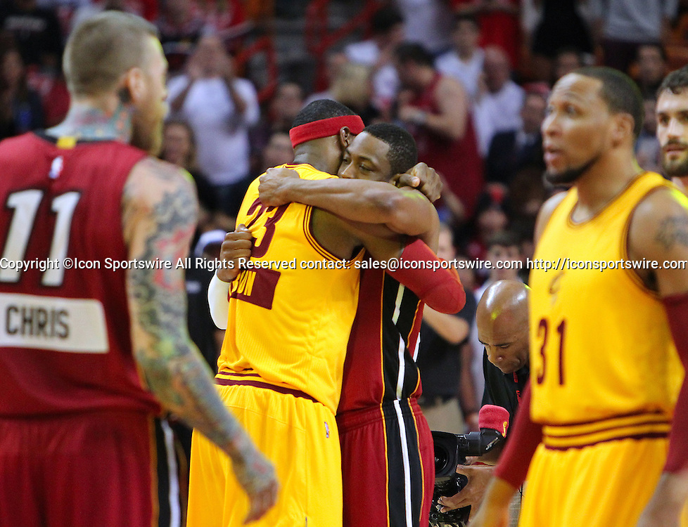Dec. 25, 2014 - Miami, FL, USA - Miami Heat guard Dwyane Wade (3) hugs former teammate Cleveland Cavaliers forward LeBron James before an NBA basketball game on Dec. 25, 2014 at the AmericanAirlines Arena in Miami. It was James's first game back in Miami after returning to the Cavaliers. The Heat won 101-91