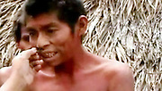 23/11/2010<br /> Seen for the first time: The Indian tribe lost in the heart of the Amazon jungle<br /> Bare to the waist and sporting rings in their upper lips, these are the extraordinary first pictures of a tribe lost in the heart of the Amazon rainforest.<br /> The natives are totally unknown to anthropologists, speak an unrecognisable language and do not even have a name for themselves.<br /> Astonishingly, their first contact with the outside world came by accident when staff at the Kugapakori Nahua Nanti nature reserve, in Peru, accidentally stumbled upon them.<br /> The nomads had been hunting for food and were tracked back to a temporary village constructed from cane and palm leaves.<br /> It was there that staff from the National Institute of Development of Andean, Amazonian and Afro-Peruvians (Indepa) studied them in secret for almost a year.<br /> They gradually began to interact with the tribe, who hunt with spears and knives, and build up a picture of their everyday lives. <br /> The discovery was eventually revealed earlier this week - along with footage of natives going about their daily lives.<br /> Mayta Capac Alatrista, the Indepa president explained how the tribe had been discovered as staff swept the area for illegal loggers.<br /> 'This contact was made because they went down to the streams in search of food,' he said.<br /> 'They are nomads. We have been able to casually initiate first contact.<br /> 'We've made a photographic record and have been able to bring them some tools that they have used to hunt, to fish and cook.'<br /> <br /> The Kugapakori Nahua Nanti park is in the south-east of Peru.<br /> Survival International, which campaigns for the rights of tribal people worldwide, estimates that there are 15 uncontacted Indian tribes in the country.<br /> These include the Cacataibo, Isconahua, Matsigenka, Mashco-Piro, Mastanahua, Murunahua (or Chitonahua), Nanti and Yora.<br /> But the organisation claims that all of them are under threat if they become connected to the outside world.<br /> 'Everything we know about these isolated Indians make