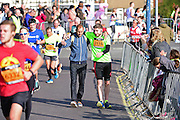 Joshua (2116) struggles with injury during The Great South Run in Southsea, Portsmouth, United Kingdom on 23 October 2016. Photo by Jon Bromley.