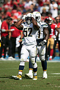 Los Angeles Chargers linebacker Denzel Perryman (52) reaches for his helmet after nearly intercepting a second quarter pass during the NFL week 4 regular season football game against the San Francisco 49ers on Sunday, Sept. 30, 2018 in Carson, Calif. The Chargers won the game 29-27. (©Paul Anthony Spinelli)