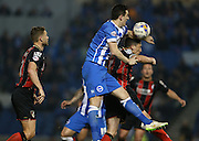 Lewis Dunk, Brighton defender and AFC Bournemouth defender Tommy Elphick during the Sky Bet Championship match between Brighton and Hove Albion and Bournemouth at the American Express Community Stadium, Brighton and Hove, England on 10 April 2015.