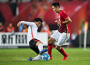GUANGZHOU, CHINA - MARCH 16:  Wang Sangyuan of Guangzhou Evergrande (R) competes for the ball with Muto Yuki of Urawa Red Diamonds (L) during the AFC Champions League match between Guangzhou Evergrande and Urawa Red Diamonds on March 16, 2016 in Guangzhou, China.  (Photo by Aitor Alcalde Colomer/Getty Images)