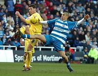 Photo: Ed Godden.<br />Reading v Preston North End. Coca Cola Championship. 25/02/2006. <br />Reading's James Harper (R) contends with Preston's Brian O'Neill for the ball.