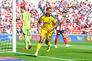 Kwesi Appiah (#9) of AFC Wimbledon runs to celebrate after scoring the equalising goal during the EFL Sky Bet League 1 match between Sunderland and AFC Wimbledon at the Stadium Of Light, Sunderland, England on 24 August 2019.