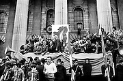Sinn Fein march to commemorate the Easter Rising 1916. Among those on the reviewing platform at the GPO are President of Sinn Fein, Ruairi O Bradaigh (fourth from left, wearing glasses) and to his left, Maire Drumm, Vice President, Sinn Fein.25/04/1976