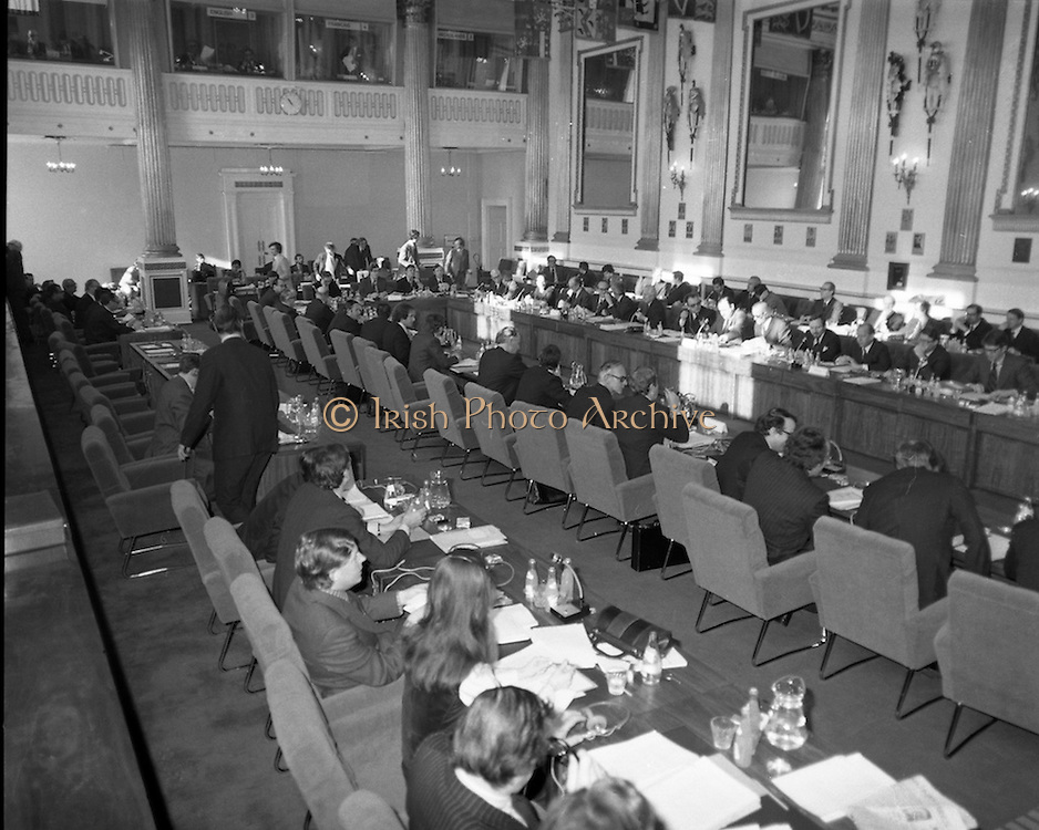 European Foreign Ministers Meet in Dublin. A meeting of European foreign ministers took place in Dublin on 13th February 1975. Ireland's representative at the meeting was Dr Garret Fitzgerald, the minister for Foreign Affairs. Other ministers attending the meeting were: Mr M.Van Eslande for Belgium, Mr M.E. Joergenson for Denmark, Mr M.M.Rumor for Italy, Mr M.Jean Sauvagnargues for France, Mr M.Gaston Thorn for Luxembourg, Mr M.M.Van der Stoel for Holland, Mr Hans-Dietrich Genscher for Germany, Mr Roy Hattersley for Great Britain and representing the Commission, Mr. M.Francois-Xavier Ortoli in St Patrick's Hall, Dublin Castle, was the venue chosen for the meeting. The image is of a general view of St Patrick's Hall, as the delegations take their places. Top left of the picture are the booths for the interpreters who no doubt would have been busy all day.