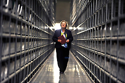 © London News Pictures. 2011/01/14 . Dr Sarah Thomas, Bodley's Librarian carries the one millionth book through some of the facility's shelving. The Bodleian Book Storage Facility (BSF) in Swindon, UK,  'ingests' its one millionth item, the book 'Journal of General Physiology Volume 1 1918-1919' on Friday, 14 January 2011. It has been achieved in just under three months and has required an average daily ingest rate of 19,000 books and periodicals per day by 32 staff. On peak days, and depending on the materials, as many as 42,000 items have been ingested. . Picture credit should read Stephen Simpson/LNP