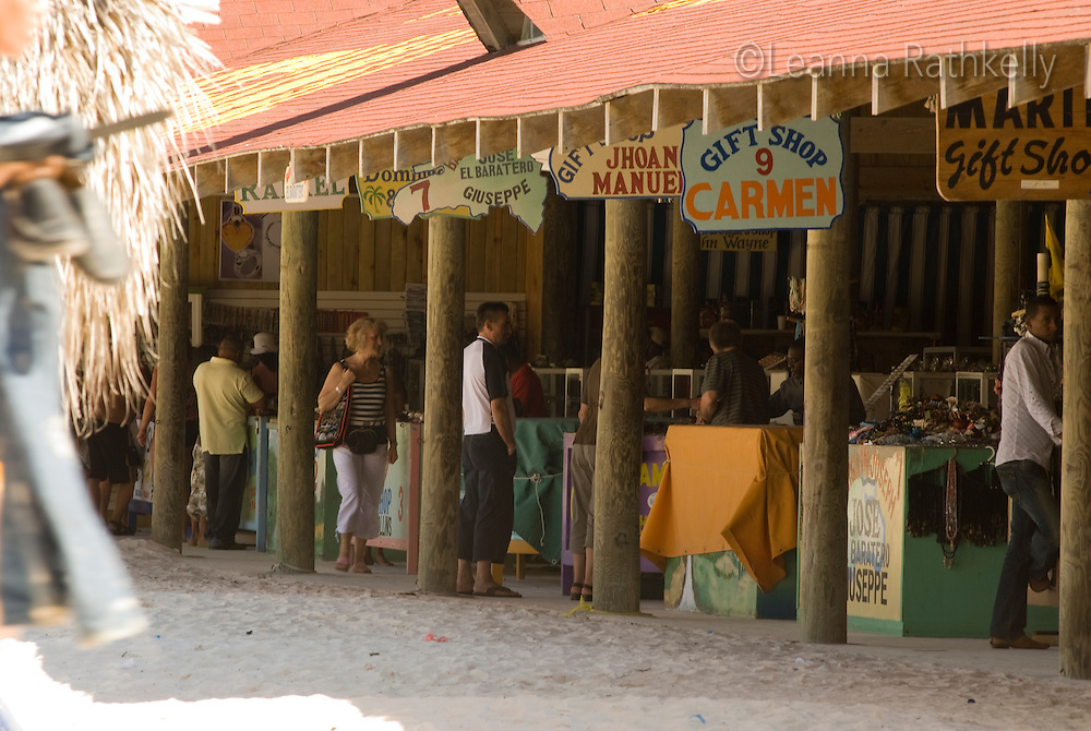 A beachside market sells local crafts and rum.