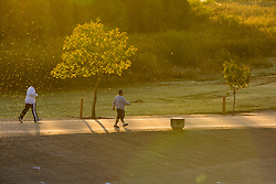 Walkers at sunrise at Storey Park in Houston, Texas