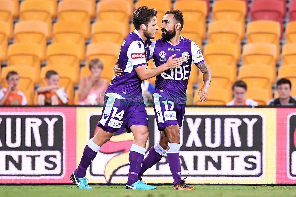 January 18, 2018 - Brisbane, QUEENSLAND, AUSTRALIA - Chris Harold of the Glory (#14, left) celebrates with team mates after scoring a goal during the round seventeen Hyundai A-League match between the Brisbane Roar and the Perth Glory at Suncorp Stadium on January 18, 2018 in Brisbane, Australia. (Credit Image: © Albert Perez via ZUMA Wire)