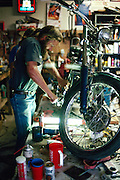 Don Rick Rickers in his garage working on his motorcycle
