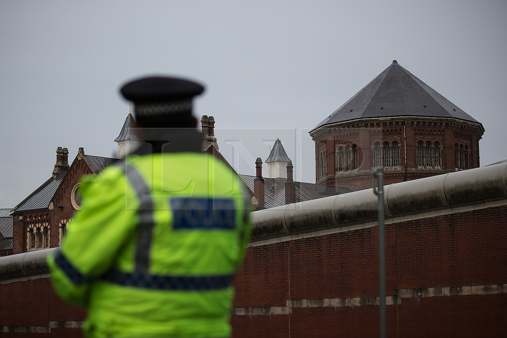 © Licensed to London News Pictures . 14/09/2015. Manchester, UK. Police at the scene where an inmate at HMP Manchester ( Strangeways Prison ) , identified locally as STUART HORNER , is conducting a rooftop protest against prison conditions . Photo credit : Joel Goodman/LNP