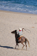 A vendor offering horse rides on the beach tries to lasso up some business on Oct. 30, 2006, in Cabo San Lucas, Mexico. (© 2006 Cindi Christie)