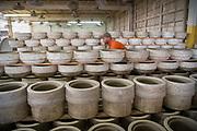 Employee Harlen Davis moves molds at Burley Clay in Roseville. Photo by Ben Siegel