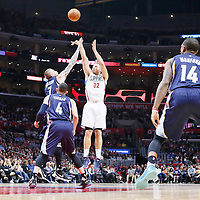 12 April 2016: Los Angeles Clippers forward Blake Griffin (32) takes a jump shot over Memphis Grizzlies forward Chris Andersen (7) and Memphis Grizzlies guard Jordan Farmar (4) during the Los Angeles Clippers 110-84 victory over the Memphis Grizzlies, at the Staples Center, Los Angeles, California, USA.