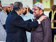 16 MARCH 2019 - BLOOMINGTON, MINNESOTA, USA: Two Twin Cities Imams chat at Dar al Farooq Center in Bloomington. An interdenominational crowd of about 1,000 people came to the center to protest white supremacy and religious intolerance and to support Muslims in New Zealand who were massacred by a white supremacist Friday. The Twin Cities has a large Muslim community following decades of Somali immigration to Minnesota. There are about 45,000 people of Somali descent in the Twin Cities.    PHOTO BY JACK KURTZ