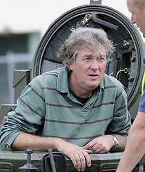 ©  licensed to London News Pictures. 01/07/2011. Gravesend, Kent.  Top Gear presenters Jeremy Clarkson, James May and Richard Hammond smashing up old houses in Gravesend, Kent with tanks during filming for Top Gear today (01/07/2011). See special instructions. Photo credit Grant Falvey/LNP.