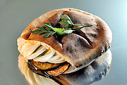 Aubergine and boiled egg in a pita (Sabich) a popular Middle-Eastern fast food and snack