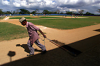 024222.SP.0114.angels12.kc--San Pedro de Macoris, Dominican Republic--Anaheim Angels Academy--The field is dragged by a groundskeeper during afternoon workouts. Dominican boys learn at a young age that baseball could be their chance to make it big. The baseball academies run by MLB teams provides an all around learning experience for boys once they reach sixteen.