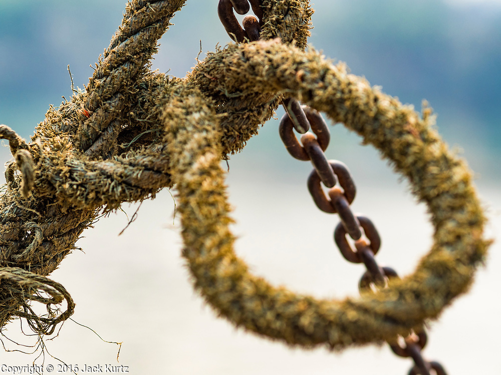 11 MARCH 2016 - LUANG PRABANG, LAOS: Rope and chain on a ferry across the Mekong River near Luang Prabang. Laos is one of the poorest countries in Southeast Asia. Tourism and hydroelectric dams along the rivers that run through the country are driving the legal economy.       PHOTO BY JACK KURTZ