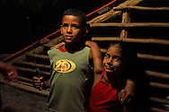 Boy and girl with a knife at a farm. Vega Yumuri, near La Maquina, Guantanamo Province, Cuba.