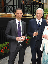 Left to right, ?, PAUL O'GRADY, at a reception for the Friends of The Castle of Mey held at The Goring Hotel, London on 20th May 2008.<br />