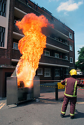 London Fire Brigage demonstrating the effects of attempting to extinguish a chip pan fire with water; Hackney; London UK