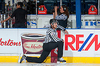 KELOWNA, CANADA - APRIL 25: Bevan Mills, linesman, stretches during warm up between the # of the Kelowna Rockets and the Portland Winterhawks on April 25, 2014 during Game 5 of the third round of WHL Playoffs at Prospera Place in Kelowna, British Columbia, Canada. The Portland Winterhawks won 7 - 3 and took the Western Conference Championship for the fourth year in a row earning them a place in the WHL final.  (Photo by Marissa Baecker/Getty Images)  *** Local Caption *** Bevan Mills;