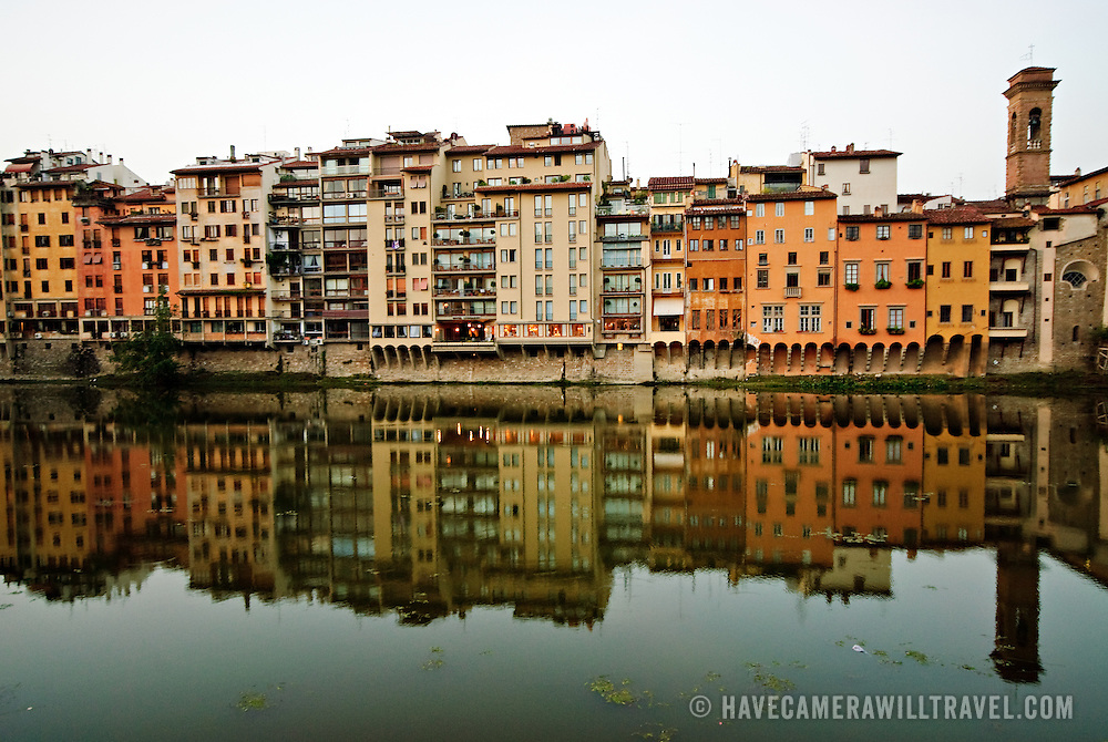 Early morning light on riverbank of the Arno in downtown Firenze with reflection
