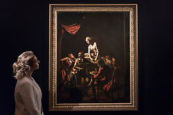 "© Licensed to London News Pictures. 01/12/2017. London, UK.  A staff member views ""An Academy of Lamplight"", 1769, by Joseph Wright of Derby, (Est. GBP2.5-3.5m).  Preview of ""Masters of Light"", Sotheby's Old Masters Evening Sale which will take place on 6 December at Sotheby's, New Bond Street. Photo credit: Stephen Chung/LNP"