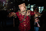 New York, NY - 31 October 2019. the annual Greenwich Village Halloween Parade along Manhattan's 6th Avenue. A chained scarecrow.