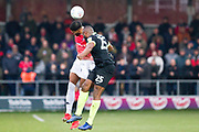 Salford City forward Jake Jervis in a challenge with Macclesfield Town defender Nathan Cameron during the EFL Sky Bet League 2 match between Salford City and Macclesfield Town at the Peninsula Stadium, Salford, United Kingdom on 23 November 2019.