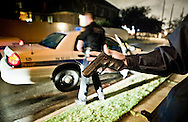 New Orleans Dec. 26, 2011 An officer  with  with the 5th District Power Squad, a specialized unit that patrols the city's toughest neighborhoods holds a gun dropped by a fleeing suspect.New Orleans murder rate is among the highest in America and is considered to be one of the most dangerous cities in the world.