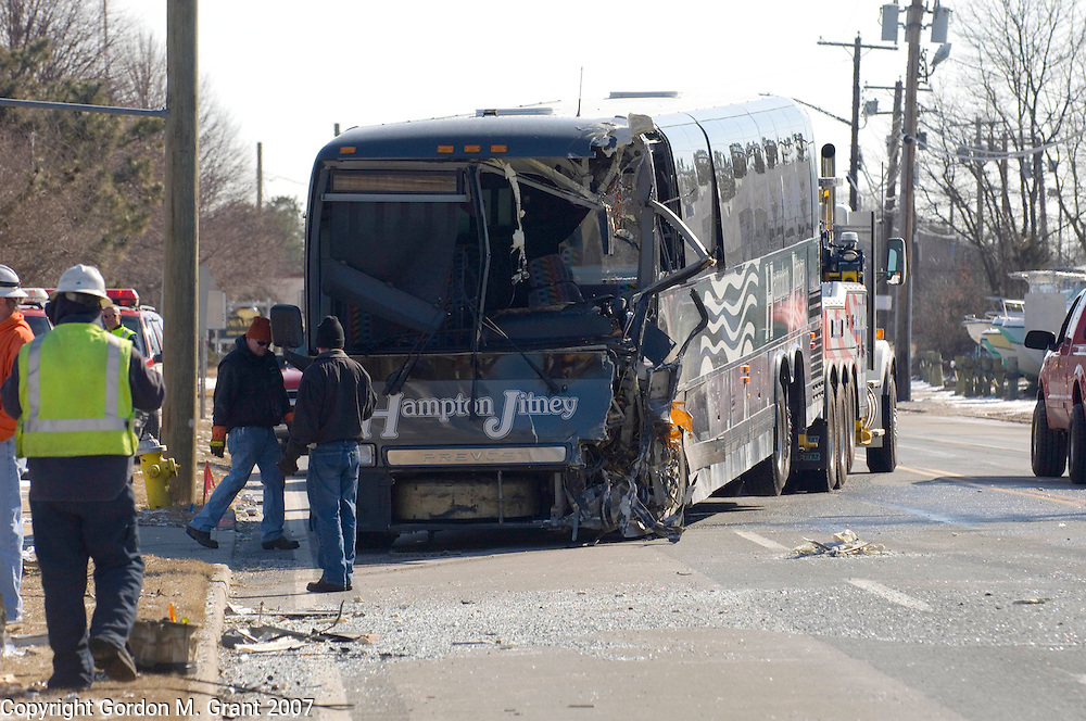Southampton, NY - 3/8/07 -   Workers remove the wreckage of a Hampton Jitney bus that was in an accident on County Road 39 near Shrubland Road in Southampton, NY March 8, 2007.  The driver of the bus was trapped in the bus and seriously injured. Injuries to passengers, if any, were not known.(Photo by Gordon M. Grant)