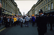Football fans and police on the streets in the city centre of Newcastle, 1999