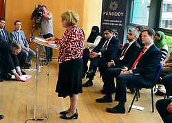 © Licensed to London News Pictures. 24/05/2013. London, UK Nick Clegg listens to Leonie Lewis from Faith Forum 4 London. Nick Clegg, Liberal Democrat MP and Deputy Prime Minister, attends a multi faith gathering with the local multi faith community at the Hugh Cubitt Peabody Centre in Islington London today 24th May 2013. After meeting privately with political and faith leaders he and they made speeches in response to the attack and death of Drummer Lee Rigby in Woolwich, calling for the community to unite against the attack. Photo credit : Stephen Simpson/LNP