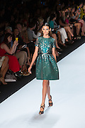 Glittery green A-line short-sleeved dress. By Monique Lhuillier at Spring 2013 Fall Fashion Week in New York.