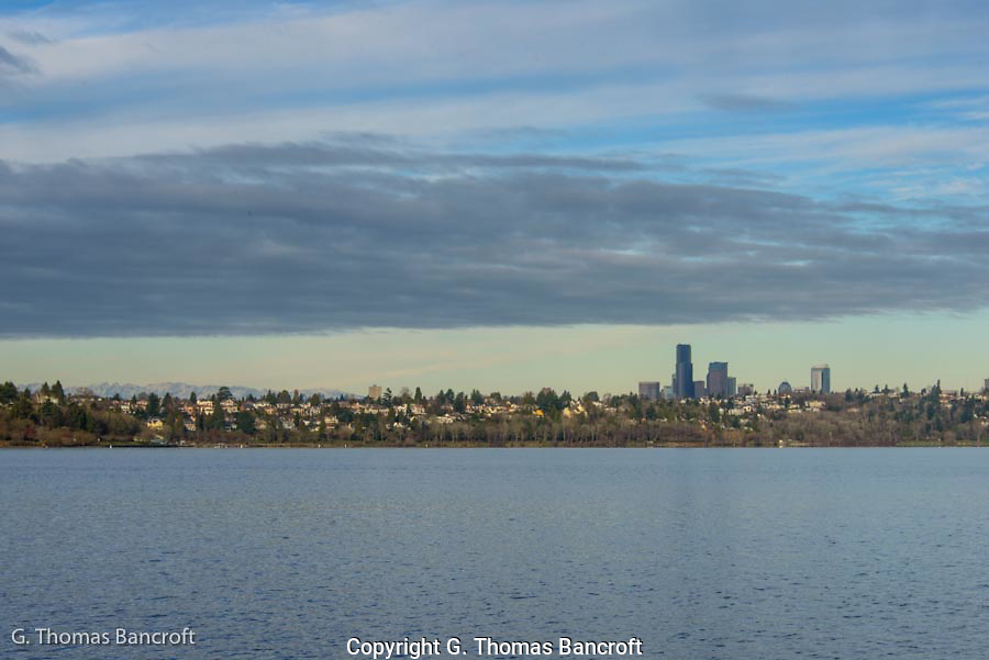 Clouds over the skyline of Seattle in the early morning from Seward Park