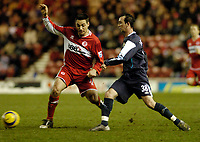 Photo: Leigh Quinnell.<br /> Middlesbrough v Manchester City. The Barclays Premiership. 31/12/2005. Middlesbroughs Doriva clashes with Man Citys Stephen Ireland.