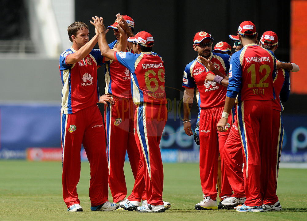 Albie Morkel of the Royal Challengers Bangalore celebrates the wicket of Michael Hussey of the Mumbai Indians during match 5 of the Pepsi Indian Premier League Season 7 between the Royal Challengers Bangalore and the Mumbai Indians held at the Dubai International Cricket Stadium, Dubai, United Arab Emirates on the 19th April 2014<br /> <br /> Photo by Pal Pillai / IPL / SPORTZPICS