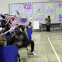 RAY VAN DUSEN/BUY AT PHOTOS.MONROECOUNTYJOURNAL.COM<br /> U.S. Army Reservist Sgt. First Class Mike Walker is met with a patriotic salute for Belle-Shivers Middle School students upon his return home from being stationed in Afghanistan.