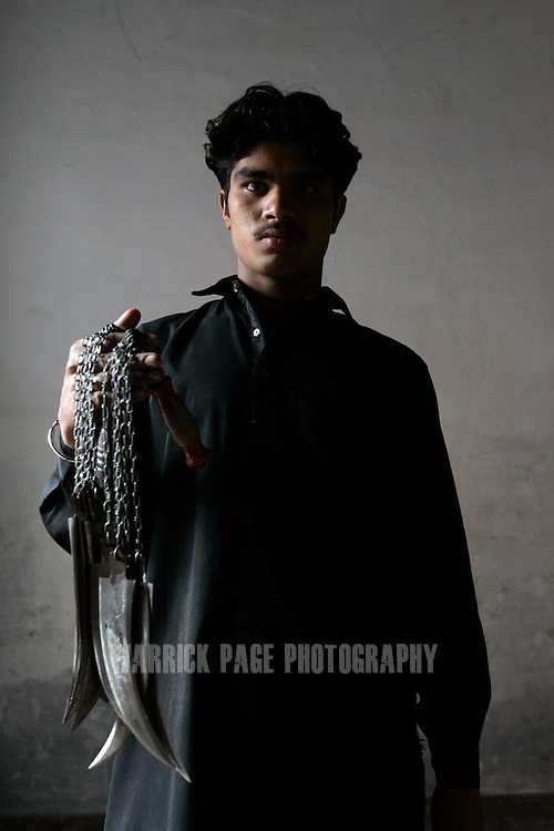 A Shia Muslim stands for a portrait during Ashura ceremonies on January 30, 2007, in Lahore, Pakistan. Millions of Muslims worldwide observe Ashura during the month of Muharram to mourn the death of the Prophet Mohammed's grandson Immam Hussain. Some Shia participate in self-flagelation to punish themselves for failing to protect the prophet's grandson. Many Shia, however, see this act as unnecessary. During the month of Muharram, many Shia's give generously to the poor and spend time in prayer. Security is stepped up every year throughout the country during Ashura due to ongoing violence between Shia and Sunni Muslim groups who frequently attack during opposing religious observances. (Photo by Warrick Page)