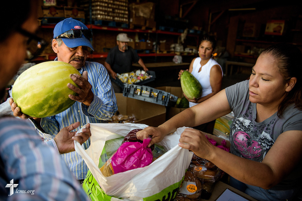 Volunteers load bags of food during a food distribution on Saturday, May 21, 2016, at Ysleta Lutheran Mission Human Care in El Paso, Texas. LCMS Communications/Erik M. Lunsford