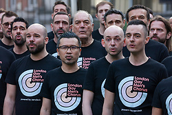 London, UK. 30th April 2019. London Gay Men's Chorus perform for survivors of the Admiral Duncan bombing, families and friends of the victims and the LGBTQ community at a service of remembrance outside St Anne's church in Soho to mark 20 years since the attack. Three people were killed and 79 injured when a bomb packed with up to 1,500 four-inch nails was detonated by a neo-Nazi at the Admiral Duncan on 30th April 1999.