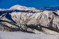 Snowboarder on Sneaky's (ski run),  Aspen/Snowmass ski resort, Snowmass Village, Colorado USA.