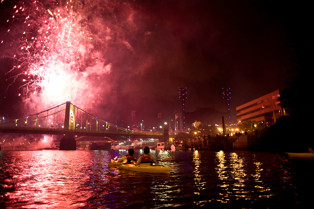 Kayakers watch fireworks following a Pirates game from the Allegheny River in Pittsburgh while  while participating in Venture Outdoors' Fireworks Paddle.