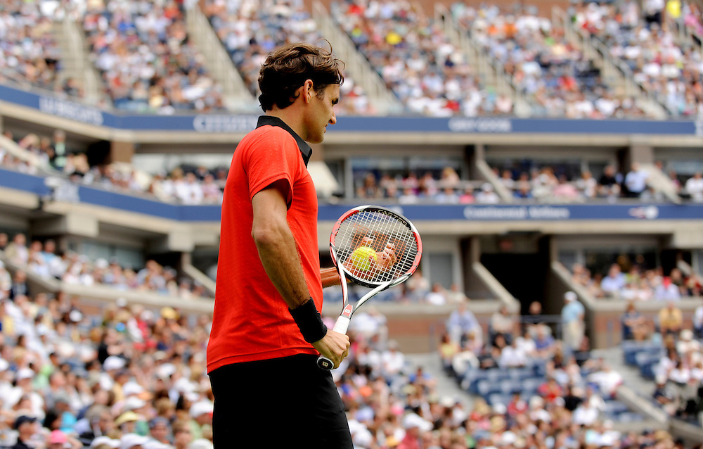 NEW YORK - AUGUST 31: Roger Federer bounces looks on during a match against Devin Britton during day one of the 2009 U.S. Open at the USTA Billie Jean King National Tennis Center on August 31, 2009 in Flushing neighborhood of the Queens borough of New York City. (Photo by Rob Tringali) *** Local Caption *** Roger Federer