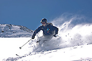 SHOT 3/12/10 11:46:15 AM - Paul Hobson of Steamboat Springs, Co. tears through some powder in a back bowl at Silverton Mountain in Silverton, Co. Silverton Mountain is unique amongst ski resorts requiring a guide (most of the season), avalanche gear and limiting the number of daily visitors. There are multiple bowls, chutes, cliffs and natural terrain features to be discovered during a visit to Silverton Mountain. It is the highest Ski Area in North America with a peak of 13,487' and it is also the steepest with no easy way down. The mountain is left in it's natural state with the exception of the avalanche reduction work which occurs. There is only one chair at the mountain though most skiiers and snowboarders will end up hiking in various directions at the top. The mountain also features heliskiing trips for $159 a trip (at the time of visit). The mountain opened in 2002. (Photo by Marc Piscotty / © 2010)