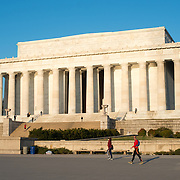 The golden light of early morning catches the eastern front of the Lincoln Memorial in Washington DC.