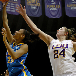 December 13, 2011; Baton Rouge, LA; UCLA Bruins guard/forward Rhema Gardner (20) shoots past LSU Lady Tigers forward Theresa Plaisance (24)during the second half of a game at the Pete Maravich Assembly Center. LSU defeated UCLA 58-41. Mandatory Credit: Derick E. Hingle-US PRESSWIRE